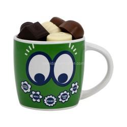 "Tasse (Mug) verte  ""Merci"" garni de 300gr de chocolats Leonidas - Leonidas Warneton (Belgique)"